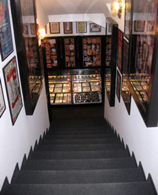 Entry staircase with show-window of jewelry and photographs of our works